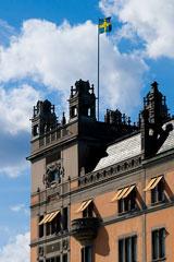 Swedish flag flying above the Swedish Riksdag (parliament) building